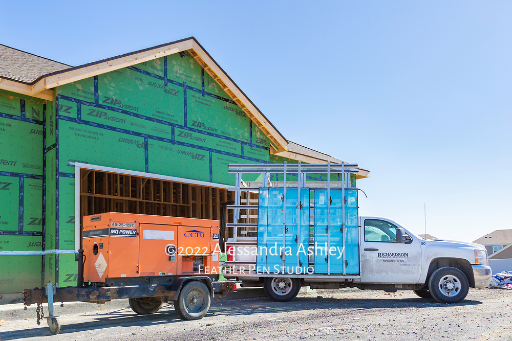 Delivery of window panes and panels arrives at construction site of future physical therapy and wellness center building.