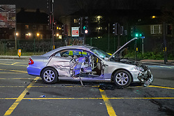 © Licensed to London News Pictures. 30/01/2021. London, UK. A damaged silver Mercedes car on the A40. A road traffic collision between a car and a bus closed the busy A40 at the junction of Wales Farm Road in Acton, the collision occurred at approximately 22:30GMT. Photo credit: Peter Manning/LNP