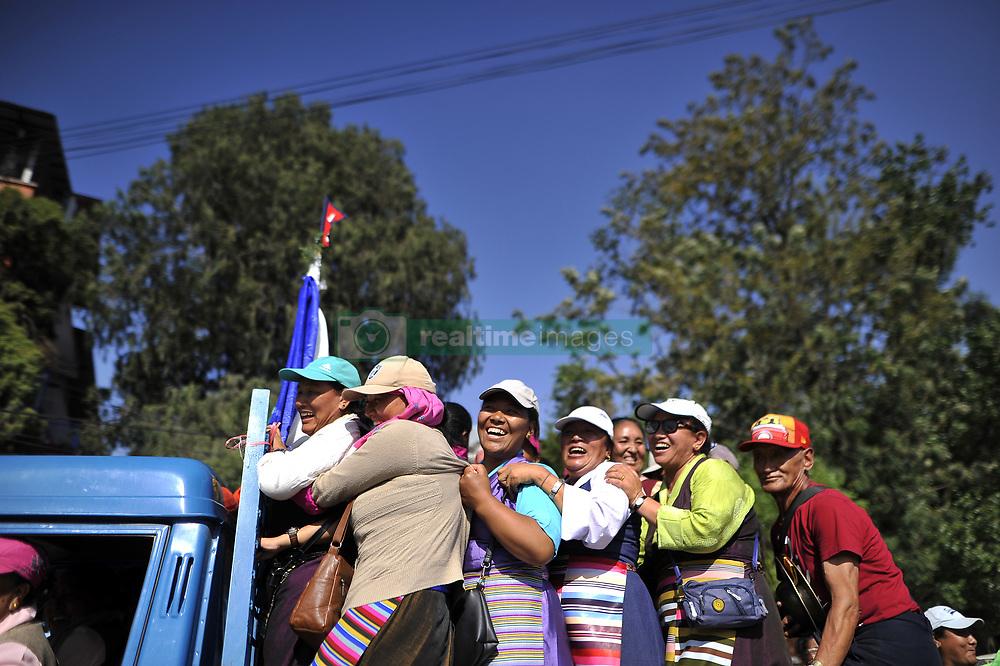 May 25, 2019 - Kathmandu, NP, Nepal - Relatives celebrates after welcome Nepali mountaineer Kami Rita Sherpa in Tribhuvan International Airport in Kathmandu, Nepal on Saturday, May 25, 2019. Kami Rita Sherpa broke his own world record for the most Everest summits on 21st May, 2019 by reaching the world's highest peak for the 24th time via S Col- SE Ridge. (Credit Image: © Narayan Maharjan/NurPhoto via ZUMA Press)