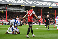Brentford Defender Yoann Barbet (29) speaks with Referee Keith Stroud as Queens Park Rangers Midfielder Pawel Wszolek (23) goes down during the EFL Sky Bet Championship match between Brentford and Queens Park Rangers at Griffin Park, London, England on 2 March 2019.