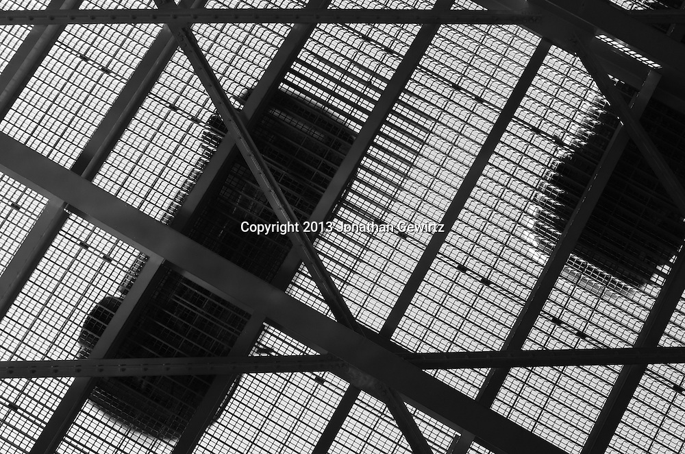 Black and white view from underneath of cars crossing a metal drawbridge. WATERMARKS WILL NOT APPEAR ON PRINTS OR LICENSED IMAGES.