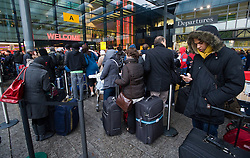 © under license to London News Pictures.  21/12/2010. Passengers queuing to enter Heathrow terminal 3 today (21/12/2010) on the fifth day of disruption following heavy snowfall at the weekend. Most flights in and out of Heathrow remain cancelled. Photo credit should read: London News PIctures.