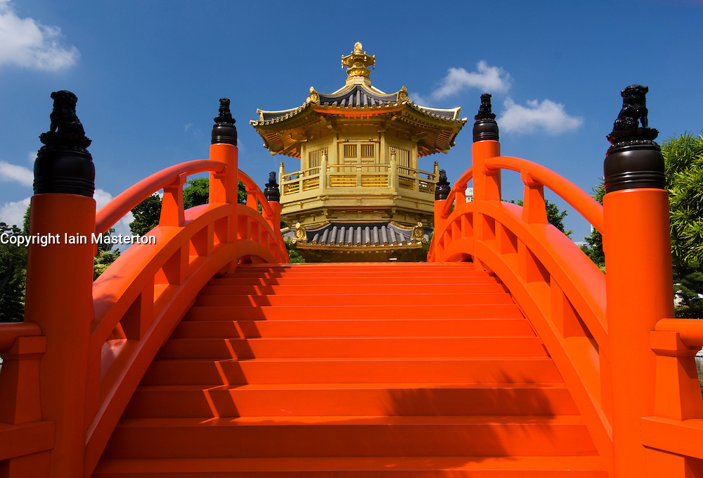 Red wooden bridge and Golden Pavilion in Nan Lian Garden adjacent to Chi Lin Nunnary in Hong Kong