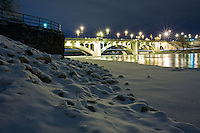December 5, 2007 - Calgary, Alberta, Canada.   The center street bridge over the Bow River in downtown Calgary.  Long Exposure at night.  This historic bridge is a major artery across the Bow River, which separates the North and South halves of Calgary.  Originally built in 1916, the bridge features upper and lower decks.  The lower deck was originally designed for pedestrian traffic only, but the design was changed to include vehicles part way through construction.