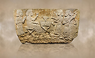 Photo of Hittite monumental relief sculpted orthostat stone panel from Water Gate Limestone, Karkamıs, (Kargamıs), Carchemish (Karkemish), 900-700 BC.  Anatolian Civilisations Museum, Ankara, Turkey.<br /> <br /> The figure sitting on a stool to the left of the table holds a goblet in his right hand which he raised upwards. Behind, there is a servant with a fan in his hand. On the other side of the table is another servant waits with a vessel in the hands. The rightmost figure plays a Saz (a stringed musical instrument) with the tassel on the handle. <br /> <br /> On a brown art background. .<br />  <br /> If you prefer to buy from our ALAMY STOCK LIBRARY page at https://www.alamy.com/portfolio/paul-williams-funkystock/hittite-art-antiquities.html  - Type  Karkamıs in LOWER SEARCH WITHIN GALLERY box. Refine search by adding background colour, place, museum etc.<br /> <br /> Visit our HITTITE PHOTO COLLECTIONS for more photos to download or buy as wall art prints https://funkystock.photoshelter.com/gallery-collection/The-Hittites-Art-Artefacts-Antiquities-Historic-Sites-Pictures-Images-of/C0000NUBSMhSc3Oo