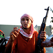 A rebel fighter gestures during the take of Muammar Gaddafi's Bab Al Azizia compound in Tripoli.