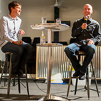 092113       Brian Leddy<br /> Retired professional road cyclists Levi Leipheimer, right, and Scott Nydam and speaks to a crowd at Stronghold Church Saturday night. Nydam, who lives in Gallup, helped bring Leipheimer to the area to race the Squash Blossom Classic mountain bike race as well as to help raise money to designate Gallup as Ride Center by the International Mountain Bike Association. Leipheimer is a two-time national road bike champion as well as an Olympic bronze medalist.
