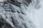 Soft water over rocks along Madcap Falls on Paradise River in Mt Rainier National Park.
