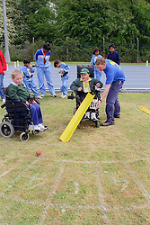 Young boys with disabilities taking part in Mini games sports event held at Stoke Mandeville Stadium,
