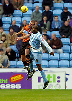 Photo: Leigh Quinnell.<br /> Coventry City v Ipswich Town. Coca Cola Championship.<br /> 19/11/2005. Ipswichs' Jason De Vos and Coventrys Dele Adebola rise for the ball.