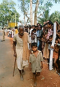 Old man with young child during festival n India
