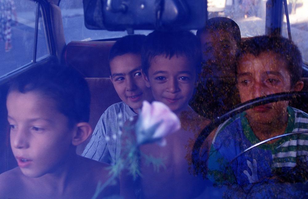 Boys playing in a car, Tashkent, Uzbekistan