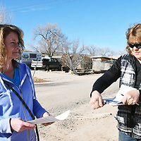 Gallup-McKinley Humane Society Director Kris Gruda, left, and Animal Control Director Cosy Balok are seen conducting outreach in Gamerco Dec. 24. The women joined members of NM Dog during outreach to educate community about the importance of spaying and neutering pets and providing adequate shelter for outdoor dogs during the winter months.