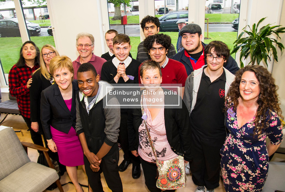 Pictured: the First Minister met Rameez (red t-shirt) and other young people who have benefitted from the help provided by the centre.<br /> <br /> The First Minister Nicola Sturgeon, MSP, joined people supported by the Thistle Foundation to bury a time capsule to mark the opening of a new health and social care centre. <br /> Ger Harley   EEm 14 June 2016