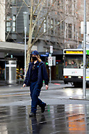 A woman wearing a facemask walks along Swanston Street during COVID-19 in Melbourne, Australia. Victoria has recorded 14 COVID related deaths including a 20 year old, marking the youngest to die from Coronavirus in Australia, and an additional 372 new cases overnight. (Photo by Dave Hewison/Speed Media)
