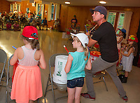 "Mr. Rich leads children from Lakes Region Child Care Services in their presentation of ""Youth Beatz"" at the Leavitt Park Clubhouse on Tuesday evening.   (Karen Bobotas/for the Laconia Daily Sun)"