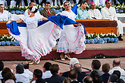 """10 JANUARY 2007 - MANAGUA, NICARAGUA:  Nicaraguan folk dancers perform at the inauguration of Daniel Ortega in Managua. Ortega, the leader of the Sandanista Front, was sworn in as the President of Nicaragua Wednesday. Ortega and the Sandanistas ruled Nicaragua from their victory of """"Tacho"""" Somoza in 1979 until their defeat by Violetta Chamorro in the 1990 election.  Photo by Jack Kurtz"""