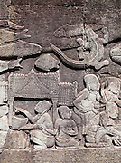 Bas relief carvings at the Bayon temple at Angkor, Siem Reap Province, Cambodia
