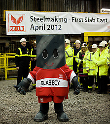© Licensed to London News Pictures. 18/04/2012..SSI Steel, Teesside, England..SSI UK mascot, Slab Boy...Two years after the closure of the Corus steel production plant, the huge blast furnace on the site in Teesside was re-lit at the weekend as the process of bringing the furnace back to operating temperature begins...Today, the furnace, now owned by the Thai company Sahaviriya Steel Industries saw the first steel slabs come out of the furnace. ..The steel will now be shipped direct to SSI in Thailand for use in the car or white good industries...Photo credit : Ian Forsyth/LNP