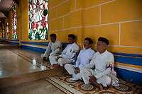 Caodai followers perform various roles of security and administration around the Great Divine Temple in Tay Ninh.