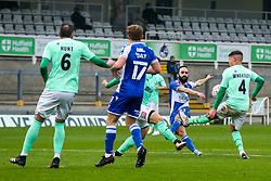 Erhun Oztumer of Bristol Rovers shoots as Joe Wheatley of Darlington challenges - Rogan/JMP - 30/11/2020 - FOOTBALL - Memorial Stadium - Bristol, England - Bristol Rovers v Darlington - FA Cup Second Round Proper.