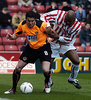 Photo. Glyn Thomas. <br /> Stoke City v Sheffield United. <br /> Coca Cola Championship. 12/03/2005.<br /> Stoke's Michael Duberry (R) battles for the ball with Wayne Thomas.