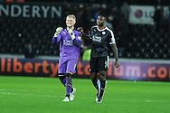 Kasper Schmeichel (l) and Wes Morgan of Leicester celebrate their teams win at end of the match. Barclays Premier league match, Swansea city v Leicester city at the Liberty Stadium in Swansea, South Wales on Saturday 5th December 2015.<br /> pic by  Andrew Orchard, Andrew Orchard sports photography.