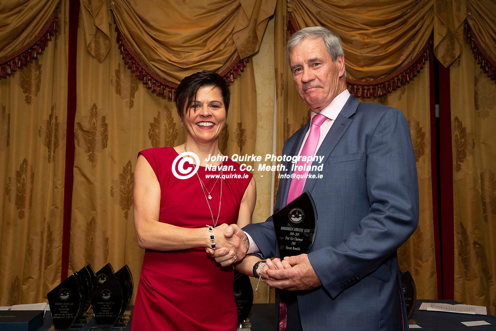 27/10/2019, Bohermeen Athletic Club 50th Anniversary celebration at the Ardboyne Hotel, Navan.<br /> Olivia Martin makes a presentation to Vincent Rennicks - first vice-chairperson of the Bohermeen AC club <br /> Photo: David Mullen / www.quirke.ie ©John Quirke Photography, Unit 17, Blackcastle Shopping Cte. Navan. Co. Meath. 046-9079044 / 087-2579454.<br /> ISO: 400; Shutter: 1/200; Aperture: 6.3; <br /> File Size: 2.4MB