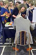 Nederland, Nijmegen, 16-3-2013Boekenfeest in Nijmegen met oa Dimitri Verhulst, Oek de Jong en Kees van Kooten, welke laatste hoofdgast, eregast was en tijd tekort kwam om voor zijn fans boeken te signeren. (let op de voeten...).Foto: Flip Franssen/Hollandse Hoogte