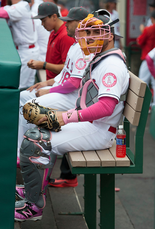 Hector Santiago, in catcher's gear, jokes around in the dugout before the Angels game against Tampa Bay Sunday at Angel Stadium.<br /> <br /> ///ADDITIONAL INFO:   <br /> <br /> angels.0509.kjs  ---  Photo by KEVIN SULLIVAN / Orange County Register  --  5/8/16<br /> <br /> The Los Angeles Angels take on the Tampa Bay Rays at Angel Stadium Sunday.<br /> <br />  5/8/16