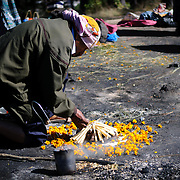Local shaman perform a traditional K'iche' Maya ceremony using censers with smouldering incense and copal resin at a site on top of a hill on Chichicastengo's outskirts. Chichicastenango is an indigenous Maya town in the Guatemalan highlands about 90 miles northwest of Guatemala City and at an elevation of nearly 6,500 feet. It is most famous for its markets on Sundays and Thursdays.