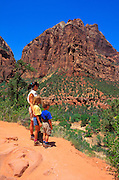 Mother and kids (ages 4 & 8) hiking the Emerald Pools trail in Zion Canyon, Zion National Park, Utah