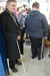 Visually impaired people with carers on outing to Denby Pottery. Mobility aid in factory.