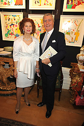 COUNT & COUNTESS FLAMBURUARI at an exhibition of her paintings 'Come to the Circus' held at Partridges Fine Art, Bond Street, London on 2nd December 2008.