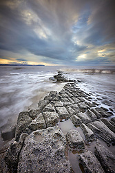 The rising tide encroaches onto the Jurassic limestone beds at Lilstock beach on the North Somerset Coast.