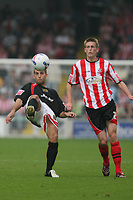 Photo: Pete Lorence.<br />Lincoln City v Milton Keynes Dons. Coca Cola League 2. 16/09/2006.<br />Paul Michell of MK Dons and Jeff Hughes in action.