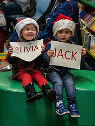EDINBURGH, SCOTLAND - DECEMBER 17   Alan Ferrier,  NRS Head of Demographic Statistics, joined babies and parents taking part in a Bookbug reading class in Muirehouse Library, Edinburgh,  today 17 December to announce this year's top 100 names for babies in Scotland. <br />Pictured: Three year old cousins, Chelsea and Alfie Malone hold up the top names of the year