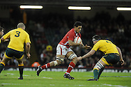 Toby Faletau © of Wales looks to go past Australia's Kane Douglas (4).  Dove Men, autumn international test, Wales v Australia at the Millennium Stadium in Cardiff on Sat 1st Dec 2012. pic by Andrew Orchard, Andrew Orchard sports photography,