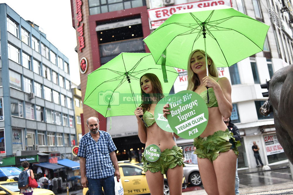 August 17, 2017 - Istanbul, Turkey - A group of PETA  (People for the Ethical Treatment of Animals) activists wearing lettuce bikini during an event promoting vegan lifestyle. (Credit Image: © Depo Photos via ZUMA Wire)