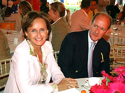 YVONNE, MARCHIONESS OF BRISTOL and RUPERT LENDRUM at the Veuve Clicquot sponsored Gold Cup or the British Open Polo Championship won by The  Azzura polo team who beat The Dubai polo team 17-9 at Cowdray Park, West Sussex on 18th July 2004.