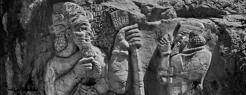 Sacred Stone - Black and white photo art print of the Hittite Ivriz rock sculpture Turkey by Paul Williams. Hittite monument, a relief from the Late Hittites Empire era (1180-700 B.C), was built by Warpalawas who Was one of the kings of Tuwana about 800 B.0 on the face plate of a rock mass besides the Ivriz River. .<br /> <br /> Visit our LANDSCAPE PHOTO ART PRINT COLLECTIONS for more wall art photos to browse https://funkystock.photoshelter.com/gallery-collection/Places-Landscape-Photo-art-Prints-by-Photographer-Paul-Williams/C00001WetsxVxNTo