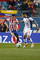 12.12.2012 SPAIN - Copa del Rey 12/13 Matchday 8th  match played between Atletico de Madrid vs Getafe C.F. (3-0) at Vicente Calderon stadium. The picture show Diego Godin (Uruguayan defender of At. Madrid)
