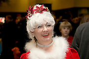 "Iowa USA, IA. Sioux City, female Santa at the ""Festival of Trees"" ? A charity event in which people sell their self-decorated Christmas trees and the profits go to charity. November 2006"