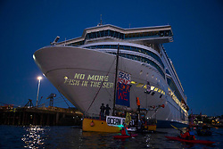 © Licensed to London News Pictures.  12/06/2021. Falmouth, UK. Extinction Rebellion activists gather around the cruise ship Silja Europa in Falmouth, Cornwall to project a message about the shipping industry; on the second day of the G7. Photo credit: Marcin Nowak/LNP