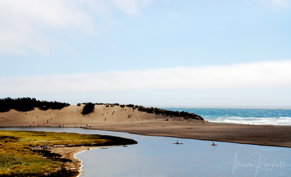Summer beach-goers and kayakers enjoy Salmon Creek Beach north of Bodega Bay