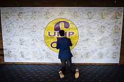 A man writes on a Ukip signature and mood board at the Ukip annual conference, Bournemouth.