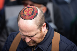 © Licensed to London News Pictures . 16/09/2018. Manchester, UK. A man wearing a Manchester United Yarmulke . Thousands of people including the UK's Chief Rabbi and several Members of Parliament attend a demonstration against rising anti-Semitism in British politics and society , at Cathedral Gardens in Manchester City Centre . Photo credit : Joel Goodman/LNP