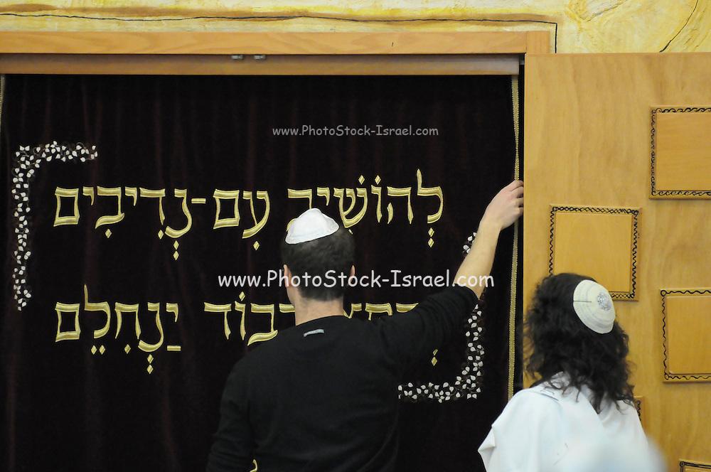 Israel, Tel Aviv, Beit Daniel, Tel Aviv's first Reform Synagogue. Opening he Ark containing the Torah scrolls for reading