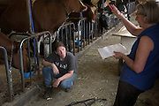 Joan Wortman, right, goes through an inventory of barn supplies and equipment with Amy Deome, left, after settling a truck load of Premier View cows into their stalls in South Randolph, Vt., Monday, May 23, 2016. (Valley News - James M. Patterson) Copyright Valley News. May not be reprinted or used online without permission. Send requests to permission@vnews.com.