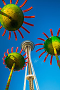 """Sonic Bloom at the foot of Seattle's Space Needle and a defining entry sculpture to the Pacific Science Center. The project was conceived as a dynamic and educational focal piece that would extend the Science Center's education outside of their buildings while engaging the public with an iconic artwork prompting curiosity and interactivity both during the day and night. The title Sonic Bloom refers not only to the defining location """"on the Puget Sound"""" but also to the artwork itself that sings as the public approaches each flower. Every flower has its own distinctive series of harmonic notes simulating a singing chorus. A hidden sensor located in each flower identifies movement and triggers the sound. So if there are 5 people engaging the flowers together, it is possible to compose and conduct music together or by walking through, randomly set off a harmonic sequence."""
